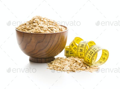 Dry rolled oatmeal and measuring tape.