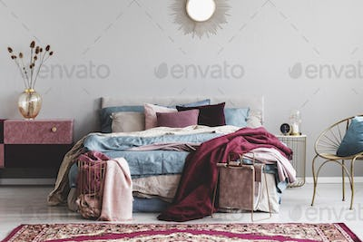 Sun shape like mirror above comfortable bed with cozy bedding
