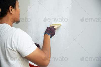 man using brush to repainting