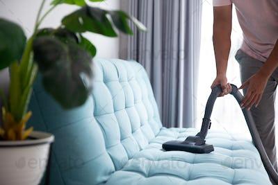 man using vacuum cleaner