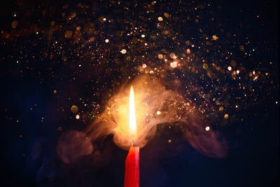 Smoke and fire texture with sparkles. Candle flame on a black background with gradient blue and