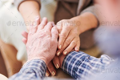Hands of aged spouses