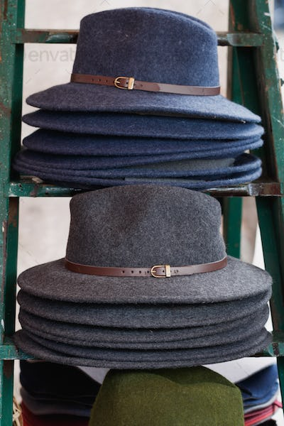 Close-up of stack of fashion female wool hats gray and blue colo