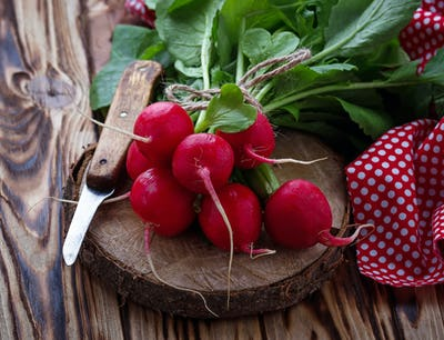 Fresh radishes and knife