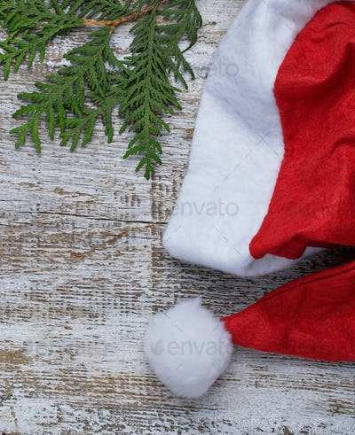 Santa Claus red hat in light wooden background