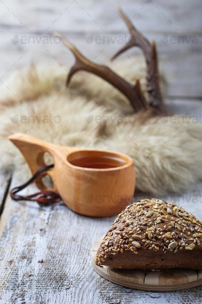 Rue bun with seeds and finnish cup kuksa