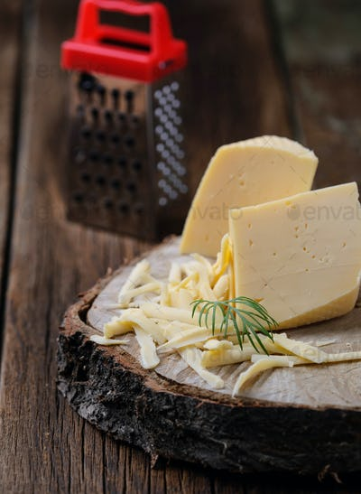 Grated cheese on wooden background