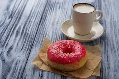 Donut and cup of coffee