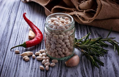 White dry beans in jar.