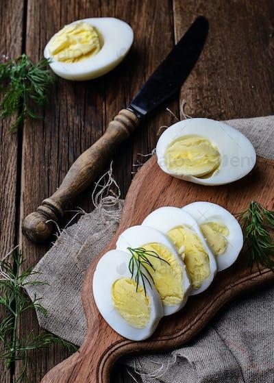 Boiled sliced chicken eggs on board
