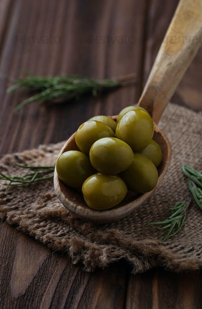 Olives in wooden spoon