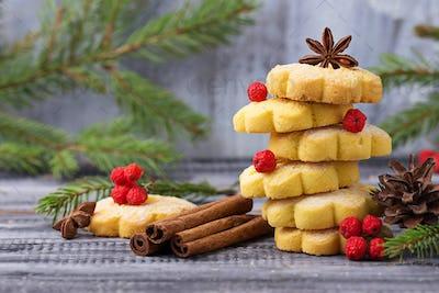 Sweet shortbread cookies in form of Christmas tree