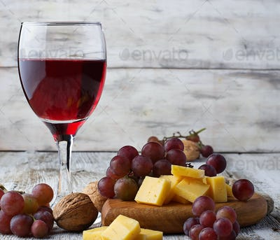Glass of red wine, grape and cheese