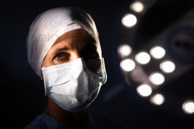 Portrait of a Caucasian female surgeon looking at the camera in the operation room in hospital