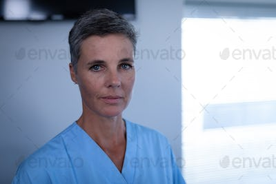 Portrait of Caucasian female matured surgeon standing in clinic at hospital