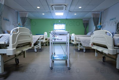 Front view of endoscopy cart machine with empty beds in row at hospital ward