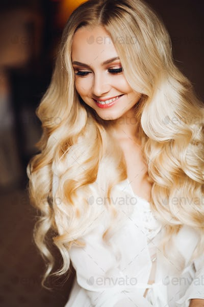 Gorgeous blondie bride dreaming and smiling