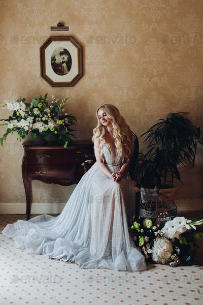 Gorgeous blondie bride in luxury interior in morning