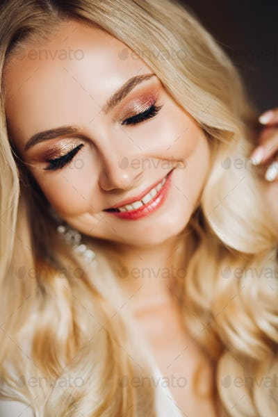 Sensuality smiling young blondie with closed eyes