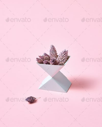Creative composition of two cardboard boxes with cones on a pink background with space for text