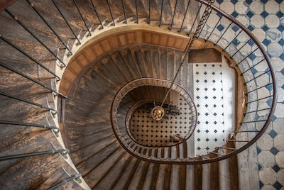 Paris, France - August 05, 2006: Beautiful vintage high spiral staircase in the gallery of Vivienne