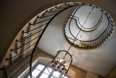 Paris, France - August 05, 2006: Spiral staircase and vintage chandelier in the gallery of Vivienne