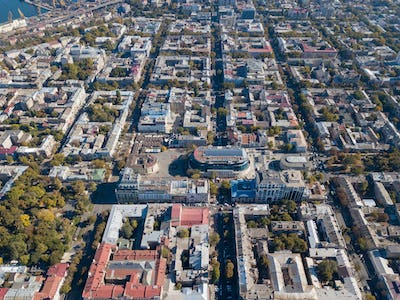 Aerial view from the drone on the shopping center, buildings and streets with cars on a sunny day