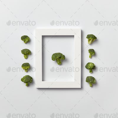 Organic vegetables pattern with broccoli in a frame and out of it on a light background