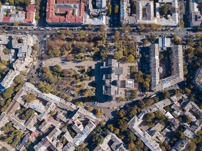 Top view of the road with cars, rooftops and the Spaso-Preobrazhensky Cathedral on a sunny day
