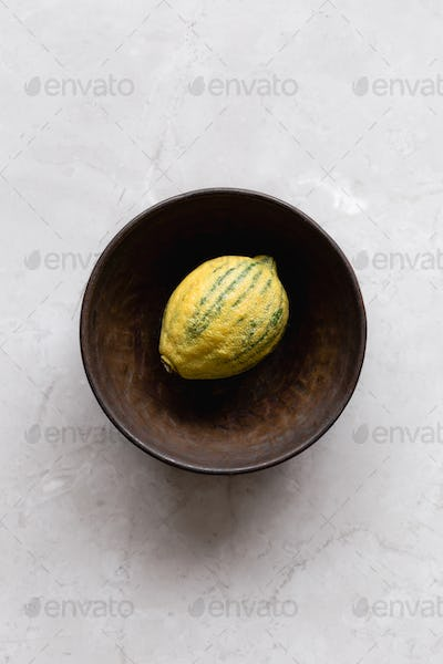 Lemon in Rustic Bowl
