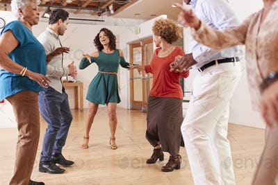 People Attending Dance Class In Community Center