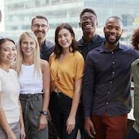 Group portrait of a creative business team standing outdoors, three quarter length, close up