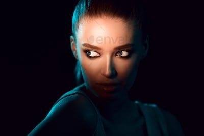Woman In Shadow. Eyes under bright light