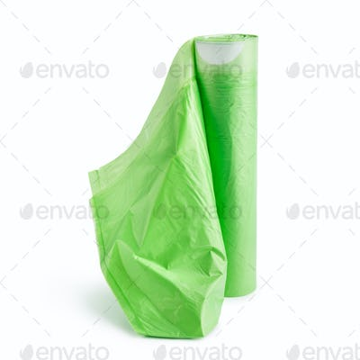 Green garbage bags on white background