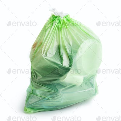 Plastic bag with trash on white