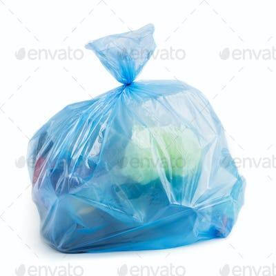 Plastic bag full of trash on white