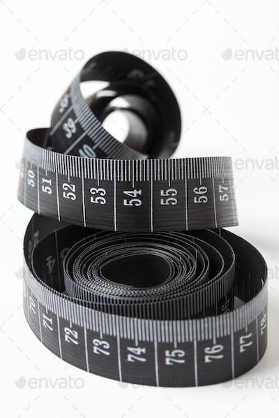 Black tape measuring.