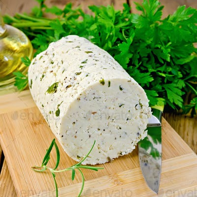 Cheese homemade with herbs and knife on board