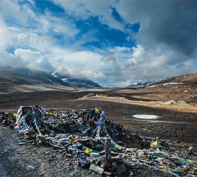 Buddhist prayer flags (lungta) on Baralacha La pass in Himalayas
