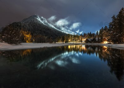 Village reflection at night in the winter countryside