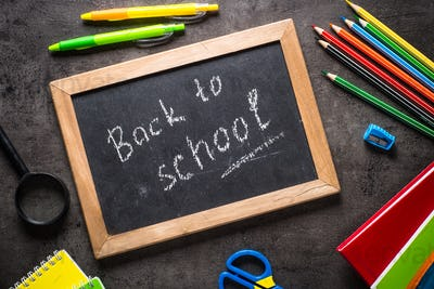 School and office stationery on black background