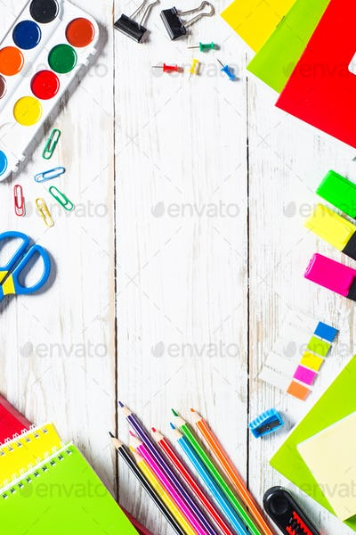 School and office supplies on white wooden table