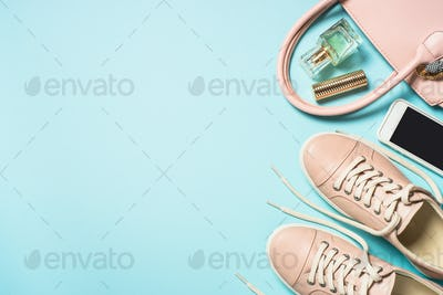 Woman accessories on blue background