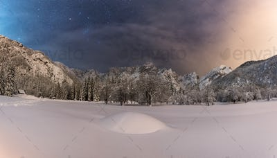 Winter landscape in the mountains under the stars