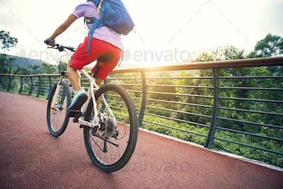 Riding bike in the sunrise