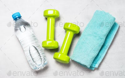 Dumbbells, water and towel top view