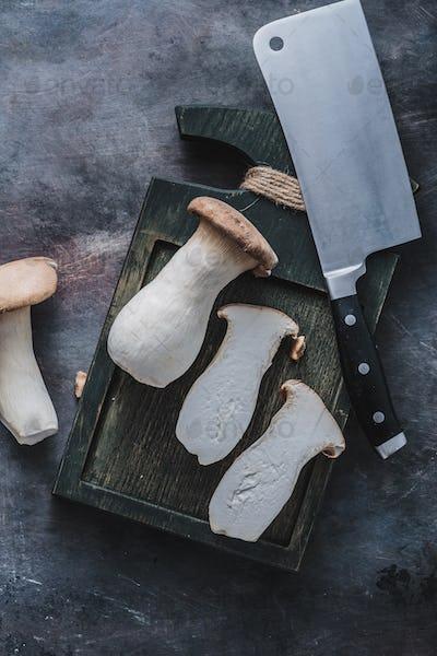 King oyster mushroom or eryngii on dark cutting board