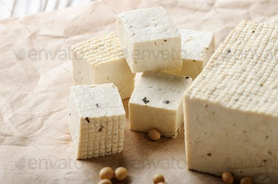 Soy Bean curd tofu on parchment paper Non-dairy alternative subs