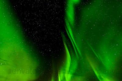 A beautiful green Aurora borealis or northern lights in Lofoten, Norway