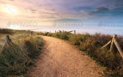 path along North sea beach at sunset